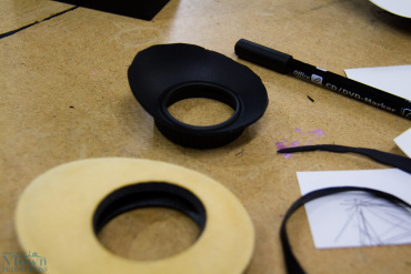 Fitting the oversized rubber eye-cup into the nice and soft eye-cushion.